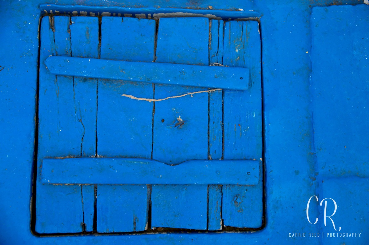 When taking photos while traveling, don't forget to look down! Sometimes great shots are under your feet, like this wooden door on a felucca sailing down the Nile in Cairo | www.carriereedphotosblog.com